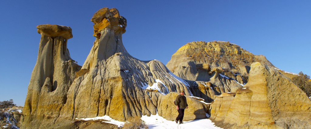 Clay pillars dwarf a hiker in this winter picture. Heavy snowfall usually closes Park roads between November and April, but the Park remains open to hikers and campers year-round. Among other activities, visitors can hunt in the fall, hike and backcoutry camp.