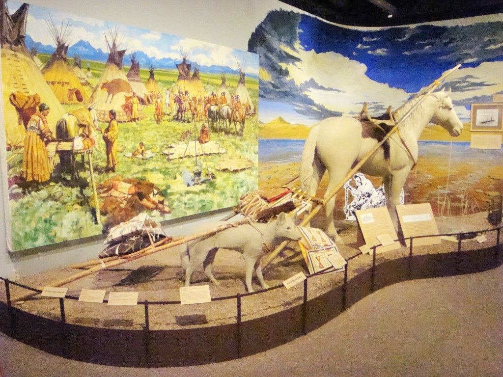 A display in the Neither Empty Nor Unknown exhibit depicts the modes of transportation used by the tribes of Montana.