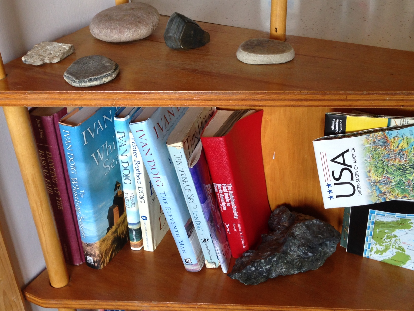 Sometimes I wonder how I ended up writing for a Montana tourism blog. Then I look at this shelf in my parents' house: random rocks, Ivan Doig, an Audubon bird guide, NPS maps...I was doomed a long time ago.